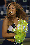 A member of Seattle Seahawks' dance Team performs  Denver Broncos  at CenturyLink Field on August 14, 2015 in Seattle Washington.  The Broncos beat the Seahawks 22-20.  © 2015. Jim Bryant Photo. All Rights Reserved.