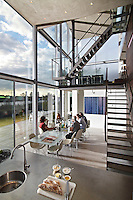 Friends gather for lunch in architect, Hans van Heeswijk's, impressive contemporary house in Amsterdam, where triple-height windows and virtually no walls create a wonderful sense of space and light.