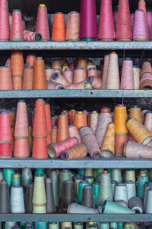 Spools of colorful thread left behind at an abandoned factory.