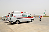 SULAIYMANIYAH, IRAQ: Ambulances carrying the bodies of the foreigners who died in the Soma Hotel fire wait at the airport to unload their caskets.<br /> <br /> On July 15, 2010 a fire in the Soma Hotel killed around 40 people including women, children and internationals from the US, Britain, Canada, Australia, Venezuela, Lebanon, South Africa, Bangladesh, the Philippines, Sri Lanka, and Cambodia..Photo by Aram Karim/ Metrography