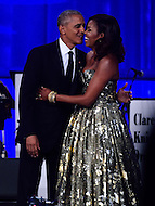 Washington, DC - September 17, 2016: President Barack Obama greets first lady Michelle Obama after speaking at the Phoenix Awards Dinner hosted by the Congressional Black Caucus Foundation at the Washington Convention Center, in the District of Columbia, September 17, 2016.  (Photo by Don Baxter/Media Images International)