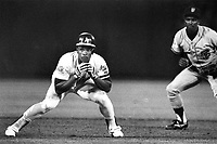 Oakalnd A's Rickey Henderson ready to run,Giants shortstop Jose Uribe watches. 1989 World Series won by the A's in four straight games. photo/Ron Riesterer