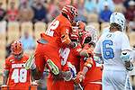29 April 2016: Syracuse's Derek DeJoe (12) jumps on the back of Scott Firman (29) while celebrating a goal. The University of North Carolina Tar Heels played the Syracuse University Orange at Fifth Third Bank Stadium in Kennesaw, Georgia in a 2016 Atlantic Coast Conference Men's Lacrosse Tournament semifinal match.