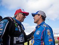 Oct 16, 2016; Ennis, TX, USA; NHRA funny car driver John Force (left) talks to Ron Capps during the Fall Nationals at Texas Motorplex. Mandatory Credit: Mark J. Rebilas-USA TODAY Sports