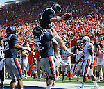 Mississippi quarterback Bo Wallace (14) and Mississippi center Evan Swindall (56) celebrate a touchdown vs. Auburn at Vaught-Hemingway Stadium in Oxford, Miss. on Saturday, October 13, 2012. (AP Photo/Oxford Eagle, Bruce Newman)..