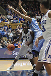 06 February 2012: Duke's Elizabeth Williams (1) is defended by North Carolina's Chay Shegog (in blue). The Duke University Blue Devils defeated the University of North Carolina Tar Heels 96-56 at Cameron Indoor Stadium in Durham, North Carolina in an NCAA Division I Women's basketball game.