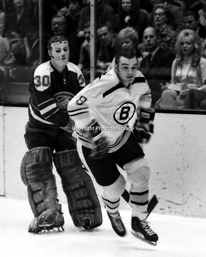 Seals vs Boston Bruins, Goalie Gary Smith and Bruin #8 Ken Hodge (1970 photo/Ron Riesterer
