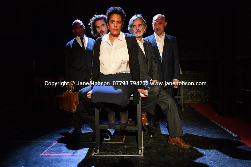 """London, UK. 10.04.2017. A brand new adaptation of Albert Camus' """"The Plague"""" opens at the Arcola Theatre. Adapted and directed by Neil Bartlett. Picture shows: Burt Caesar (Grand), Billy Postlethwaite (Mr Rambert), Sara Powell (Dr Rieux), Martin Turner (Mr Tarrou), Joe Alessi (Mr Cottard). Photograph © Jane Hobson."""