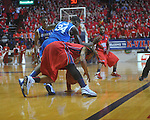 Kentucky's DeAndre Liggins (34) fouls Ole Miss guard Trevor Gaskins (23)  at the C.M. &quot;Tad&quot; Smith Coliseum in Oxford, Miss. on Tuesday, February 1, 2011. Ole Miss won 71-69.