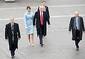 United States President Donald Trump walks with First Lady Melania Trump back to the Capitol Building after a Marine One helicopter takes off with former President Barack Obama after Trump is sworn in at the 58th Presidential Inauguration on Capitol Hill in Washington, D.C. on January 20, 2017.  <br /> Credit: John Angelillo / Pool via CNP