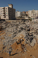 Gaza city.  Workers clean the rubble of a former nine stories building in downtown Gaza used to house former palestinian prisioners in Israel. The building was bombed by the Israeli air force during  military campaign known Operation Cast Lead, meant to silence Hamas rocket attacks inside Israel.  The conflict resulted in between 1,166 and 1,417 Palestinian and 13 Israeli deaths (4 from friendly fire)  7 of whose were killed in this place. (PHOTO: MIGUEL JUAREZ LUGO).