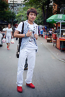 Wangyajun, a movie and tv crew worker and cinematographer, age 20, poses for a portrait in Beijing. Response to 'What does China mean to you?': 'China is extremely great!'  Response to 'What is your role in China's future?': 'I want to become an excellent cinematographer!'