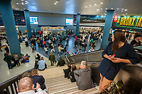 Hundreds of people pack Penn Station in New York on Friday, April 14, 2017 after an NJ Transit train lost power in the Hudson Tunnel. Trains in and out of Penn Station, NJ Transit, Amtrak and the LIRR were subject to considerable delays. The 1200 people on the train were trapped for three hours. (© Richard B. Levine)