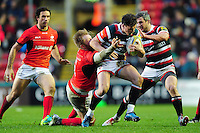 Freddie Burns of Leicester Tigers takes on the Saracens defence. Aviva Premiership match, between Leicester Tigers and Saracens on January 1, 2017 at Welford Road in Leicester, England. Photo by: Patrick Khachfe / JMP