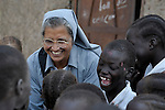 Sister Ninet D'Costa, FMA, a Catholic nun from India, is a teacher trainer in Malakal, Southern Sudan. Sister D'Costa came to the war-torn African country under the auspices of Solidarity with Southern Sudan, an international network of Catholic groups supporting Southern Sudan with educational personnel and prayer. Here Sister D'Costa greets students at a school in Detang, a small village across the Upper Nile River from Malakal. NOTE: In July 2011 Southern Sudan became the independent country of South Sudan.