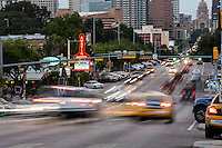 Traffic shoots up and down the fast-paced South Congress Avenue, a popular shopping district always packed with tourists and locals alike - Stock Image.