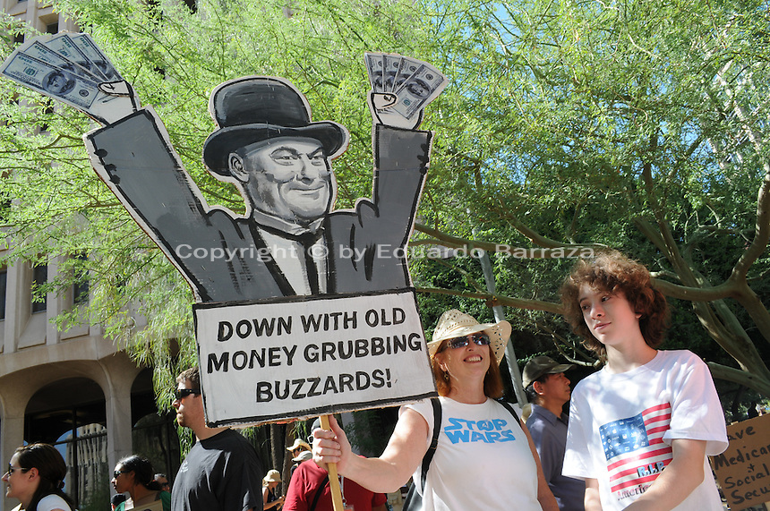 "The ""Occupy Phoenix"" protest drew hundreds of demonstrators to the Cesar Chavez Plaza in Downtown Phoenix, Arizona. The demonstration is a replica of the ""Occupy Wall Street"" movement that emerged in New York to protest economic disparities in the United States. Photo by Eduardo Barraza © 2011"
