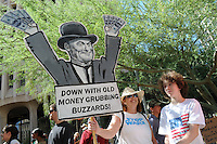 """The """"Occupy Phoenix"""" protest drew hundreds of demonstrators to the Cesar Chavez Plaza in Downtown Phoenix, Arizona. The demonstration is a replica of the """"Occupy Wall Street"""" movement that emerged in New York to protest economic disparities in the United States. Photo by Eduardo Barraza © 2011"""