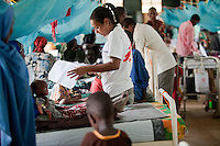 Doctors Without Borders pediatrician Luana Lima checking on patients at the aid group's hospital in Dagahaley refugee camp in Kenya. July 2011.