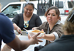 """Juani Martinez, a Methodist woman in Nuevo Laredo, Mexico, serves food to Cuban immigrants in that city's Plaza Benito Juarez on March 3, 2017. Hundreds of Cubans are stuck in the border city, caught in limbo by the elimination in January of the infamous """"wet foot, dry foot"""" policy of the United States. They are not allowed to enter the U.S. yet don't want to return to Cuba. Many of the city's churches have become temporary shelters for the immigrants, and congregations rotate responsibility for feeding the Cubans, who have slowly been forced to appreciate Mexican cuisine. Such solidarity from ordinary Mexicans is being tested these days, as not only are the Cubans stuck at the border, but the U.S. has stepped up deportations of Mexican nationals, while at the same time detaining many undocumented workers from other nations and simply dumping them on the US-Mexico border. Martinez is a member of the Aposento Alto Methodist Church in Nuevo Laredo."""