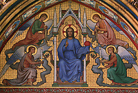 Detail of painting above the doorway and below the rose window in the high chapel depicting Jesus Christ in a canopy similar to the reliquary on the opposite side, Upper chapel, La Sainte-Chapelle (The Holy Chapel), 1248, Paris, France. La Sainte-Chapelle was commissioned by King Louis IX of France to house his collection of Passion Relics, including the Crown of Thorns. Picture by Manuel Cohen