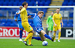 St Johnstone v Hibs...02.10.10  .Murray Davidson tackles Kevin McBride.Picture by Graeme Hart..Copyright Perthshire Picture Agency.Tel: 01738 623350  Mobile: 07990 594431
