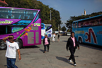 Tour bus drivers bring loads of tourists in for boat tours of the Golden Triangle on the Mekong River in Sop Ruak, Thailand. Photo taken on Thursday, December 10, 2009. Kevin German / Luceo Images