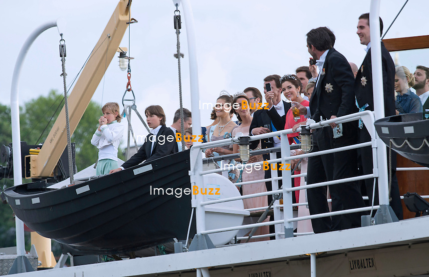 ROYAL GUESTS<br /> take a boat ride to Drottingholm Palace for the Wedding Banquet Riddarholmen, Stockholm, Sweden_08/06/2013<br /> Princess Madeleine married Christopher O'Neill at the Royal Chapel, Royal Palace in Stockholm
