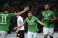 FUSSBALL   1. BUNDESLIGA  SAISON 2011/2012  30. SPIELTAG 10.04.2012 SV Werder Bremen - Borussia Moenchengladbach  JUBEL Werder Bremen;  Sokratis Papastathopoulos (Mitte) und Totschuetze zum 2-2 Ausgleich Naldo.