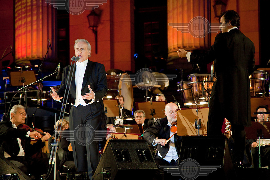 Tenor Jose Carreras performs during the Berlin Classic Open Air concerts held every summer in the restored Gendarmenmarkt square which was heavily damaged during the Second World War (WWII). The orchestra is the Brandenburgischen Staatsorchester Frankfurt conducted by David Gimenez. .