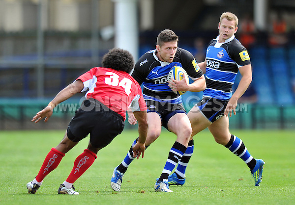 Jack Cuthbert in possession. Pre-season friendly match, between Bath Rugby and London Welsh on August 11, 2012 at the Recreation Ground in Bath, England. Photo by: Patrick Khachfe / Onside Images