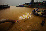 The city of Zhenjiang's Titanium Powder Factory discharges chemical sewage straight into the Yangtze River: only 1000 meters downstream from this sewage outlet is the source for the water intake of the Waterworks of Dangyang City. Jiangsu Province. June 10, 2009.