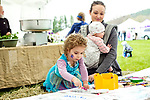 Woodbury, CT- 22 April 2017-042217CM04-  Rhienna Murray of Monroe watches as her daughter Ares, 3 colors during the 22nd Annual Woodbury Earth Day celebration at Hollow Park in Woodbury on Saturday. Also with her is her other daughter Akiranova 9 months old.  The event sponsored by Pomperaug River Watershed Coalition, featured vendors, resources and demonstrations from conservation-minded stores, artists and food vendors.  Christopher Massa Republican-American