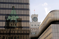 The Fairmont Hotel Vancouver, Birks Clock, and Sears department store  reflected in a glass building, Vancouver, British Columbia, Canada