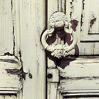 An antique door knocker is seen hung on the rotten wooden door of a Spanish colonial house in Morelia, Mexico, 3 November 2014.