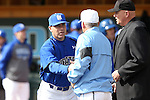 13 February 2015: Seton Hall head coach Rob Sheppard (left) shakes hands with UNC head coach Mike Fox as umpire John Haggerty (right) watches. The University of North Carolina Tar Heels played the Seton Hall University Pirates in an NCAA Division I Men's baseball game at Boshamer Stadium in Chapel Hill, North Carolina. UNC won the game 7-1.