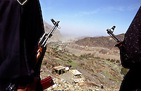Members of the army overlook the Khyber Pass. Below this lookout point the Grand Trunk Road crosses the border into Afghanistan.