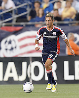 New England Revolution forward Diego Fagundez (14) at midfield. In a Major League Soccer (MLS) match, the New England Revolution defeated Columbus Crew, 2-0, at Gillette Stadium on September 5, 2012.