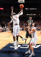 CHARLOTTESVILLE, VA- DECEMBER 6: Assane Sene #5 of the Virginia Cavaliers is fouled by Ryan Pearson #24 of the George Mason Patriots during the game on December 6, 2011 at the John Paul Jones Arena in Charlottesville, Virginia. Virginia defeated George Mason 68-48. (Photo by Andrew Shurtleff/Getty Images) *** Local Caption *** Ryan Pearson;Assane Sene