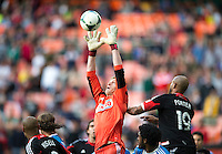Zac MacMath (18) of the Philadelphia Union goes up for a cross during the game at the RFK Stadium in Washington DC.  Philadelphia defeated D.C. United, 3-2.