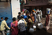 Local residents gather to collect water in the early hours of the day at the low cost neighbourhood of Sangam Vihar in New Delhi, India. Photo: Sanjit Das for The Foreign Policy