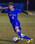 UK defender Dustin Scibilia crosses over the ball as he pushes up the near line into Xavier's half.