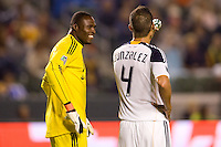 LA Galaxy players GK Donovan Ricketts (l) and defender Omar Gonzalez (r) chat during a delay in the game. The LA Galaxy defeated the Columbus Crew 3-1 at Home Depot Center stadium in Carson, California on Saturday Sept 11, 2010.