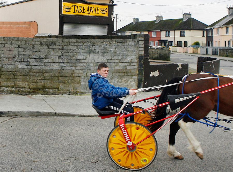 A boy rides his sulkey through Saint Marys Park Limerick.