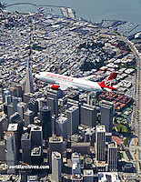 aerial photograph Virgin America Airbus a320 over downtown San Francisco, California
