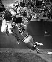 Oakland A's Manny Alexander throw to first to complete double play as Cleveland's Rick Manning goes out of his way to break up the play (Photo 1978 by Ron Riesterer)