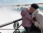 Mother kissing her two year old girl at Niagara Falls, Ontario, Canada.