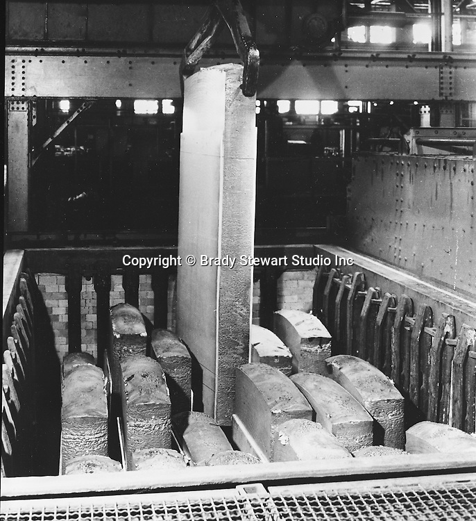 Pittsburgh PA:  View of steel molds in furnace pit - 1959.  Swindell Dressler International Company was based in Pittsburgh, Pennsylvania. The company was founded by Phillip Dressler in 1915 as American Dressler Tunnel Kilns, Inc.  In 1930, American Dressler Tunnel Kilns, Inc. merged with William Swindell and Brothers to form Swindell-Dressler Corporation. The Swindell brothers designed, built, and repaired metallurgical furnaces for the steel and aluminum industries. The new company offered extensive heat-treating capabilities to heavy industry worldwide.