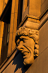 "Gargoyle on side of building at sunset grotesque expression on face along the ""Ave"" University District Seattle Washington State USA"
