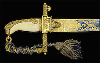 BNPS.co.uk (01202 558833)<br /> Pic: JamesD.Julia/BNPS<br /> <br /> Ornately decorated.<br /> <br /> Special relationship - Only American born Captain at Trafalgar's ceremonial sword for sale.<br /> <br /> A rare 212-year-old sword presented to a captain for his bravery at the Battle of Trafalgar has emerged for sale.<br /> <br /> The pristine bronze gilted weapon was awarded to Captain William Rutherford of the 74-gun HMS Swiftsure for his role in helping the British to victory in 1805.<br /> <br /> Only 23 of the 100 Guinea Sword were awarded to captains from the world's most famous naval battle.<br /> <br /> This one is being sold by James D Julia Auctions and has an estimate of &pound;200,000 ($250,000), but could fetch a lot more.